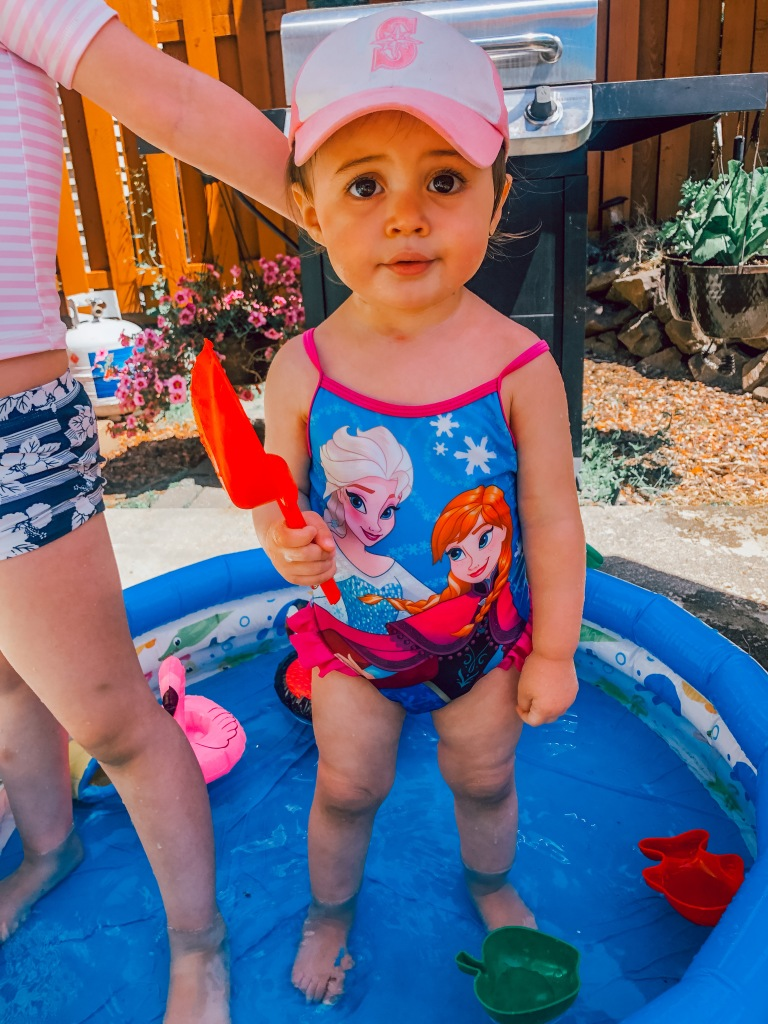Kiddie pool time with Frozen bathing suit
